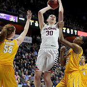 Breanna Stewart, (center), UConn, shoots past Marina Laramie, (left) and Jada Payne, East Carolina, during the UConn Huskies Vs East Carolina Pirates Quarter Final match at the  2016 American Athletic Conference Championships. Mohegan Sun Arena, Uncasville, Connecticut, USA. 5th March 2016. Photo Tim Clayton