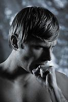studio portrait of handsome blond man torso naked doing workout