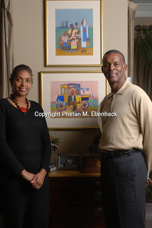 Darden Restaurants CEO Clarence Otis, right, and his wife, Jacqui Bradley, with some of their collection of African-American art at their home in Orlando, Florida.
