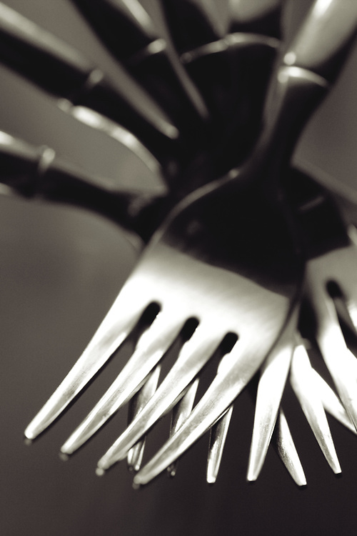 multi forks fanned out verticle black and white