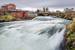 A roaring Spokane River as it races down the cascades in the middle of the city of Spokane Washington.