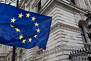 As the EUs Chief negotiator Michel Barnier meets Theresa May in London to discuss the next stage of Brexit, the stars of the EU flag belonging to to anti-Brexiter flies in Whitehall and the corner of Downing Street, the official residence of the Prime Minister, on 5th February 2018, in London England.