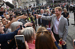 Prince Harry meets members of the public outside Windsor Castle ahead of Harry's wedding to Meghan Markle this weekend.