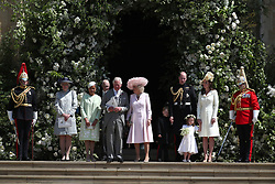 Doria Ragland, the Prince of Wales, the Duchess of Cornwall, the Duke and Duchess of Cambridge with Prince George and Princess Charlotte leave St George's Chapel in Windsor Castle after the wedding. leave St George's Chapel in Windsor Castle after their wedding.