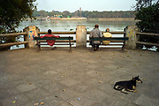 People and a dog watch the Hoogly, Chandannagar, India