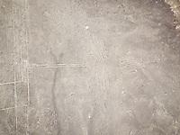 Aerial close up view of geometric shapes geoglyph in Nazca, Peru.