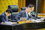 21 AUGUST 2014 - BANGKOK, THAILAND:     PORNPETCH WICHITCHOLCHAI (center), President of the Thai National Legislative Assembly (NLA) relaxes after the NLA selected Gen Prayuth Chan-ocha to be Prime Minister. The NLA was hand selected by the Thai junta, formally called the National Council for Peace and Order (NCPO), and is supposed to guide Thailand back to civilian rule after a military coup overthrew the elected government in May. The NLA unanimously selected General Prayuth Chan-ocha, commander of the Thai Armed Forces and leader of the coup in May that deposed the elected civilian government, as Prime Minister. Prayuth is Thailand's 29th Prime Minister since the 1932 coup that created Thailand's constitutional monarchy.    PHOTO BY JACK KURTZ