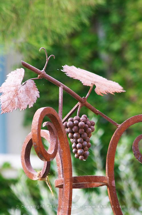 Wrought iron decoration: a grape bunch leaves and vine. Chateau de Beaucastel, Domaines Perrin, Courthézon Courthezon Vaucluse France Europe