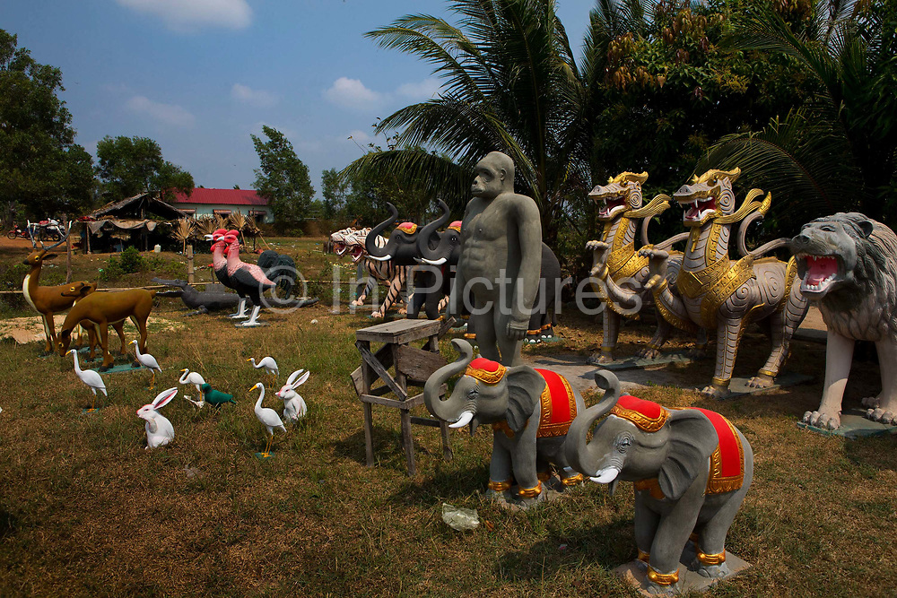 Plaster animals for sale in a roadside shop, Along Veng, Angkor temple complex.