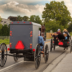 Two Amish Buggies in Lancaster County on a country road.