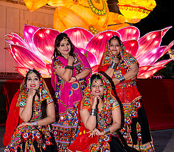 Ross Bandstand, Princes Street Garden, Edinburgh, Scotland, United Kingdom, 23 October 2019. Diwali Festival of Lights: Diwali Festival of Lights: Switch on of illuminations for Edinburgh Diwali with festive Indian dancers. The festival includes a number of events between October 23rd-26th. The festival culminates with a parade through the city on Saturday. Pictured: Edinburgh Dandiya performers.<br /> Sally Anderson | EdinburghElitemedia.co.uk