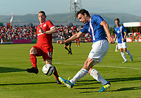 Fotball<br /> 17.07.2013<br /> Foto: Sportsfile/Digitalsport<br /> NORWAY ONLY<br /> <br /> 17 July 2013; Vegard Forren, Molde FK, in action against Lee Lynch, Sligo Rovers. UEFA Champions League Second Qualifying Round, First Leg, Sligo Rovers v Molde FK, The Showgrounds, Sligo.