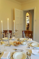 Table laid out for Christmas dinner with crackers and Staffordshire Chinaware