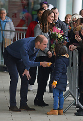 The Duke and Duchess of Cambridge greet well-wishers as they depart following a visit to Coach Core Essex in Basildon.