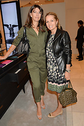 Left to right, KATIE MARTIN and AMANDA KYME at a lunch hosted by Alice Naylor-Leyland and Tamara Beckwith in celebration of the Coach 2015 collection held at Coach, New Bond Street, London on 18th September 2014.