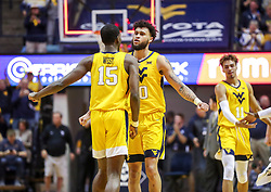 Mar 20, 2019; Morgantown, WV, USA; West Virginia Mountaineers guard Jermaine Haley (10) dunks the ball and celebrates with West Virginia Mountaineers forward Lamont West (15) at the end of the first half against the Grand Canyon Antelopes at WVU Coliseum. Mandatory Credit: Ben Queen