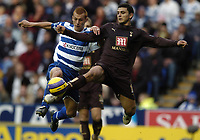 Photo: Jonathan Butler.<br /> Reading v Tottenham Hotspur. The Barclays Premiership. 12/11/2006.<br /> Steve Sidwell of Reading fights for the ball with Hossam Ghaly of Tottenham.