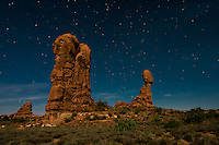 Long exposure of balanced rock in Arches National Park in Utah's Moab Desert lit entirely by moonlight.