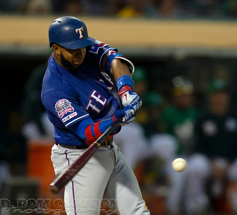 Jul 25, 2019; Oakland, CA, USA; Texas Rangers Danny Santana (38) connects for an RBI double during the fifth inning of a baseball game at Oakland Coliseum. Mandatory Credit: D. Ross Cameron-USA TODAY Sports