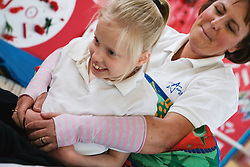 Child with physical and learning disabilities in an exercise class,