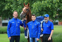 Trainer Charlie Appleby (left), winning jockey William Buick (centre) and groom Saeed pose with Masar during the homecoming event at Moulton Paddocks, Newmarket.
