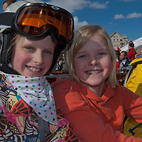 Youngsters relax on the sun deck at Big Sky ski area, Big Sky, Montana.