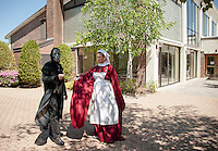 Death Eater - Mark Sawyer and Hogwart's Nurse Madame Pomfrey - Piper Kirby stroll through the courtyard during Misti-Con 2015 held at the Margate Resort on Saturday afternoon.   (Karen Bobotas/for the Laconia Daily Sun)