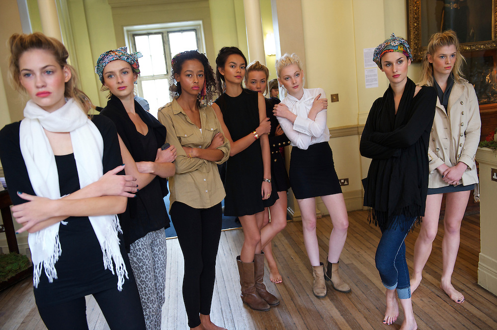 Still in their street clothes, models listen to the producer's directions during a walk through rehearsal before the Saloni autumn/spring 2010/2011 show in the map room of the Royal Geographical Society, South Kensington, London on 20 September 2010.