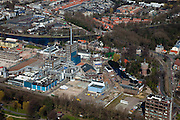 Nederland, Zuid-Holland, Delft, 20-03-2009; Delfse Vliet met fabrieksterrein van DSM Gist (Gist-Brocades). Producent van o.a. penicilline en andere antibiotica en  ingredienten voor levensmiddelen. Rechts voormalige Watertoren, huisvest tegenwoordig een waterwinkel, centrum voor (spirituele) cursussen, zaalverhuur. Geheel links restanten van de gesloopte Calvé fabriek waar o.a. pindakaas gemaakt werd. Factory site of the former Calvé Delft and factories DSM Gist (Gist-Brocades). Producer of penicillin and other antibiotics and ingredients for food..Swart collectie, luchtfoto (toeslag); Swart Collection, aerial photo (additional fee required).foto Siebe Swart / photo Siebe Swart