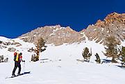 Backcountry skier climbing Piute Pass, Inyo National Forest, Sierra Nevada Mountains, California