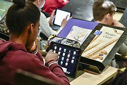 March 28, 2019 - Des Eleves Travaillent avec leurs Tablettes Numerique (Credit Image: © Panoramic via ZUMA Press)