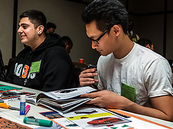 IRVINE, CA - MARCH 2: Students Ricardo Lozano(L) and Andy Lee(R) create collages from magazines clips at the Treasure Room during create collages from magazines clips at the Treasure Room during the Working Wardrobes Dream Girls & Distinguished Gentlemen 2013 event at the Irvine Hilton in Irvine, CA. Working Wardrobes (http://www.workingwardrobes.org) is a non-profit organization located in Costa Mesa, CA. PHOTO: © 2013 SILVEX.PHOTOSHELTER.COM.