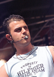 """Abs (full name Richard Abidin Breen) of the Boy band Five performing on stage at """" Feel The Noise"""". A Local Radio stations (Rock FM)  charity pop event which was held at Blackburn Rovers Football Ground Saturday 2nd June 2001."""