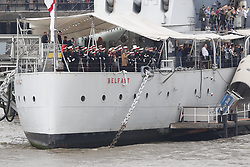 © Licensed to London News Pictures. 24/10/2018. London, UK. British Royal Marines are joined by the The Royal Netherlands Marines in a military demonstration at HNLMS Zeeland, which is anchored next to anchored next to HMS Belfast on the River Thames in central London. Members of the British and Dutch Royal families watched the event as part of a state visit to the UK. Photo credit: Peter Macdiarmid/LNP