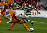 Motherwell v Celtic, Scottish Premier League, Fir Park, Motherwell.  Pic ian Stewart, Saturday 30th July 2005<br /> Craigan trips Petrov and gets bookerd