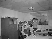 Y-480923-04.  Slot machine raid. Detective Mike Elliot. 3 Star Tavern, 8343 SW Barbur Blvd (now site of the Boom Boom Room) September 23, 1948