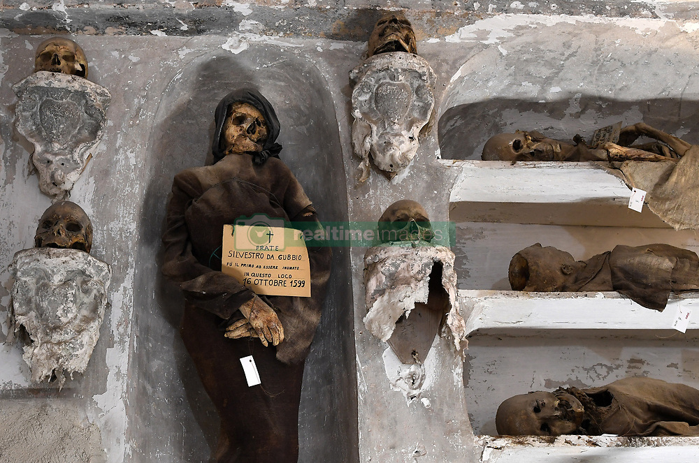 NO WEB FOR FRANCE - The Capuchin Catacombs of Palermo, Sicily, Italy on January 2019. Mummie of brother Silvestro of Gubbio (16 oct. 1599) the oldest of the catacombs. The catacombs contain about 8000 corpses and 1252 mummies. Palermo's Capuchin monastery outgrew its original cemetery in the 16th century and monks began to excavate crypts below it. In 1599 they mummified one of their number, recently dead brother Silvestro of Gubbio, and placed him into the catacombs. The cemetery was first reserved for ecclesiastical workers, then accepted deceased from all walks of life, and experienced its greatest popularity during the 19th century. An inscription hanging from the neck or pinned to the chest, indicates the name, birth and death dates of the deceased.The cemetary was officially closed by civil order in 1880. But the last burials are from the 1920s. The cemetary has now become a kind of museum, filled with the forgotten dead, who are watched over by a group of Capuchin monks. Sicily will reveal over time a real research laboratory on mummification. It is spreading throughout the island and there is not an important village in sight that does not display the bodies of their priests, monks or citizens in the crypt of their church. Photo by Eric Vandeville/ABACAPRESS.COM