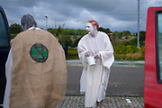 "Extinction Rebellion Penitents getting ready to protest for climate change at Truro Cathedral in Cornwall at 11am on the 28th of August 2020 in Truro, United Kingdom. Based on the medieval idea of repenting transgressions against your community by wearing sackcloth and ashes whilst bearing your ""sins"" around your neck. The Penitents performed in total silence in this highly visual ceremony. Starting at the Truro Park and Ride they travelled into Truro and walked in procession through the town before carrying out the ceremony. These protests are highlighting that the government is not doing enough to avoid catastrophic climate change and to demand the government take radical action to save the planet.<br /> <br /> Extinction Rebellion is a climate change group started in 2018 and has gained a huge following of people committed to peaceful protests. These protests are highlighting that the government is not doing enough to avoid catastrophic climate change and to demand the government take radical action to save the planet."