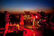 "Drinks on an evening game drive in the Phinda Game Reserve. <br /> <br /> Phinda Private Game Reserve encompasses an impressive 23 000 hectares (56 800 acres) of prime conservation land wilderness in KwaZulu-Natal, South Africa. Showcasing one of the continent's finest game viewing experiences. Phinda is described as ""Seven Worlds of Wonder"", with its seven distinct habitats - a magnificent tapestry of woodland, grassland, wetland and forest, interspersed with mountain ranges, river courses, marshes and pans. Phinda is a wilderness sanctuary where intimate encounters, adventure and rare discoveries can be experienced firsthand."