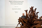 Chinese artist Ai Weiwei poses for photographers with his work The Cover Page of The Mueller Report, Submitted to Attorney General William Barr by Robert Mueller on March 22, 2019 made from Lego and  Martin 2019 at the opening of  his new exhibition Ai Weiwei: Roots at the Lisson Gallery, London, United Kingdom on 1st October 2019.