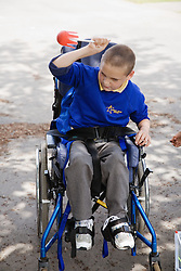 Boy with cerebral palsy in a wheelchair,