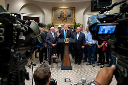 May 23, 2019 - Washington, DC, United States of America - U.S. President Donald Trump joined by Agriculture Secretary Sonny Perdue, left, delivers remarks in support of farmers and ranchers during an event in the Roosevelt Room of the White House May 23, 2019 in Washington, DC. (Credit Image: © Tia Dufour via ZUMA Wire)