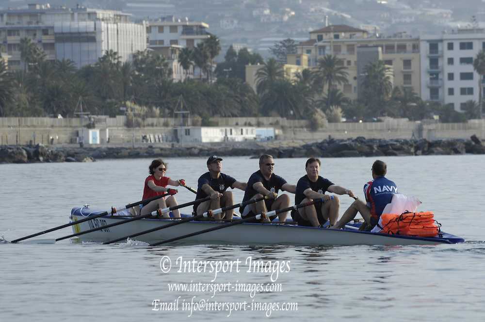 San Remo, ITALY, Mayflower Offshore Club crew, leaving the beach area to take part in the Sunday open competition,  2008 FISA Coastal World Championships. Sunday 19/10/2008. [Photo, Peter Spurrier/Intersport-images] Coastal Rowing Course: San Remo Beach, San Remo, ITALY