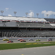 The pack of race cars drive down the front stretch during the 57th Annual NASCAR Coke Zero 400 race first practice session at Daytona International Speedway on Friday, July 3, 2015 in Daytona Beach, Florida. The seating is undergoing an upgrade and will ready in time for the 2016 race. (AP Photo/Alex Menendez)