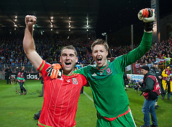 ZENICA, BOSNIA & HERZEGOVINA - Saturday, October 10, 2015: Wales Sam Vokes and Wales goalkeeper Wayne Hennessey celebrate after securing a place at next years Euro Championships after the Bosnia & Herzegovina vs Wales match at the Stadion Bilino Polje during the UEFA Euro 2016 qualifying Group B match. (Pic by Peter Powell/Propaganda)