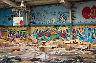 July 2, 2015, New Orleans, LA, graffiti covered abandoned gymnasium in the upper 9th Ward. The gym was built on top of the Agricultural landfill in an area that determined to be a superfund site. Many blighted buildings remain in the area since Hurricane Katrina.