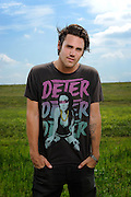 Jason Evigan of L.A.-based band After Midnight Project photographed backstage on Warped Tour, July 5, 2010