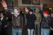 Moscow, Russia, 15/12//2010..Russian nationalist youths make fascist salutes near Kievsky railway station, where police detained up 1,000 people during an operation to prevent ethnic riots. There were scuffles as hundreds of riot police were deployed to prevent clashes between Russian nationalists and traders from the Caucasus, many of whom work at a market near the station.