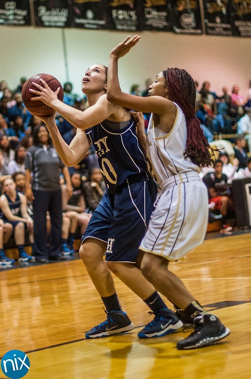 Hickory Ridge's Haley Ratliff looks to shoot against Concord's Jessica Williams Friday night at Concord High School. Hickory Ridge won the game 55-35.