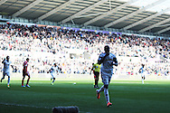 Swansea city's Roland Lamah celebrates after he scores his sides 1st goal. Barclays Premier league match, Swansea city v West Bromwich Albion at the Liberty Stadium in Swansea, South Wales on Saturday 15th March 2014. pic by Andrew Orchard,  Andrew Orchard sports photography.